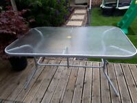 6 seater glass table in good condition