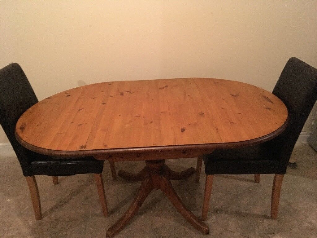 Solid pine drop down table and 2 chairsin Sileby, LeicestershireGumtree - Solid pine drop down table with 2 brown leather chairs in good condition 60ono 07960044582