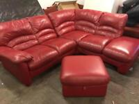 Red leather corner sofa with footstool