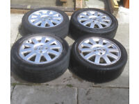 """set of genuine renault 16"""" alloy wheels with all center caps , 4 x 100 pcd"""