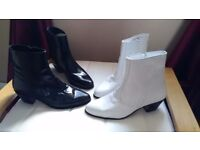 Two pairs of leather boots, one white pair, one black pair