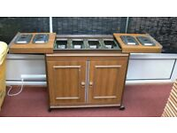 ECKO HOSTESS trolley with Four trays with lids over glass dishes and heated cabinet