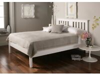 White wooden double bed with under bed storage