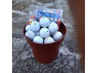 A bucket of Golf Balls & Tees