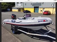Ribeye 400 boat with 50hp Tohatsu engine, road trailer & accessories. Ex cond & fully serviced.