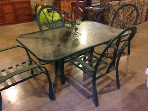 Patio dining table and chair set.