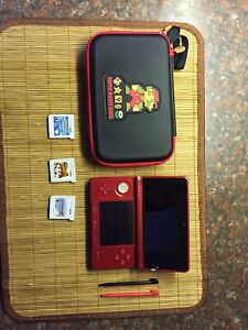 Red 3ds with 3 games and Case
