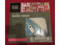 Brand new in box Heated Throw