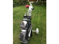 golf bag with clubs & trolley ---- great starter set.