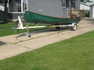 18' Frieghter canoe with trailer and outboard motor