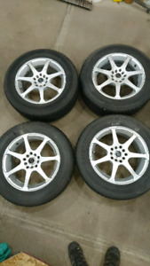 Firestone 215 60 r16 tires and rims
