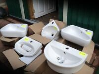 Selection of white washroom wall hung handbasins