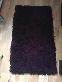 Fluffy purple rug