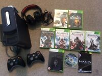 Xbox 360 with headset, 2 x controllers and 8 games.