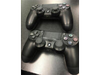 Official Sony PlayStation 4 Controllers in Black in mint condition