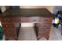 Leather desk with a lockable drawer