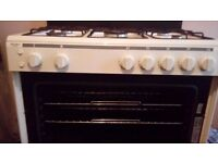 A gas white range cooker