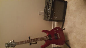 Candy apple red LTD electric guitar with fender amp