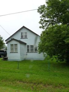 Two bedroom house, large heated garage and private double lot