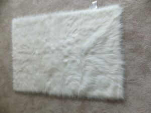 "FOR SALE 5 New White quilted blankets 45""x30"" - $20.00 each. Cal"