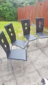 X4 faux leather dinning room chairs with Chrome legs. Good condition couple of marks on them.