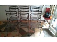Six stylish Heals metal dining chairs