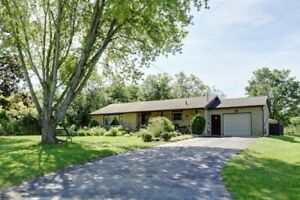 Country living close to Cobourg on large half acre lot!