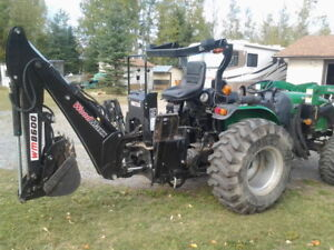43 HP, 4 wheel drive tractor, 8 ft backhoe, rototiller , snow bl