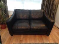 Black leather 3 seater 2 seater sofas, chair and footstool.