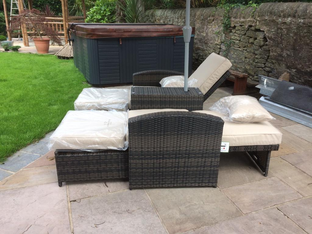 Rattan love seat (reclinersin Mottram, ManchesterGumtree - Rattan garden furniture setDouble recliners joined with central tableComes with Parasol included