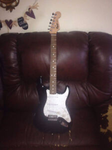 fender squier electric guitar and acoustic guitar