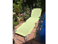 2 contemporary fold up sun loungers