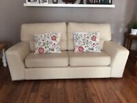 Two 3 seater faux leather sofas