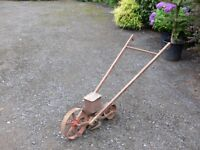 Antique furrower and seed sower, needs restoration