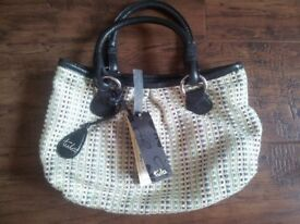 Tula navy leather and straw hand bag fully lined with labels. Cost £43, sell for £25