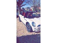 White Mini Cooper Convertible- Side Walk Edition