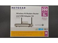 Netgear Wireless-N Modem Router and USB Adapter kit.