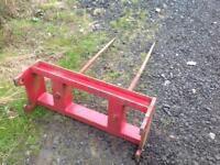 Front loader bale spike