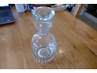a good quality heavy glass wine or port decanter TREAD the Globe