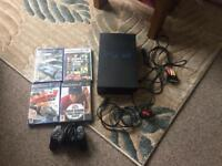 PlayStation 2 with controller and games