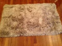 Brand new silver shaggy rug