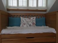 Mama and Papa's golden oak cot bed