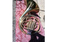 French horn, made by Orsi in Italy. Very well used, tarnished in many areas, couple of dings.