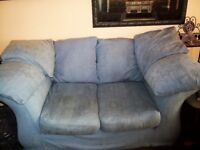 Sky blue 2 seater sofa with 6 cushions