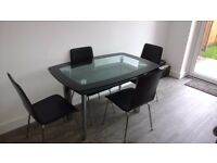 Glass Dinning table with 4 dining chairs