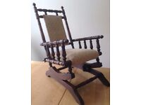 Reupholstered childs antique rocking chair.