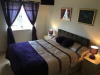 King size bed in double room in 4 bedroom home