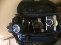 Film cameras, film and bag.