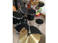 Drum kit with muffler pads, stool and sticks can deliver