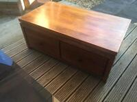 Dark solid wood 4 drawer chest coffee table